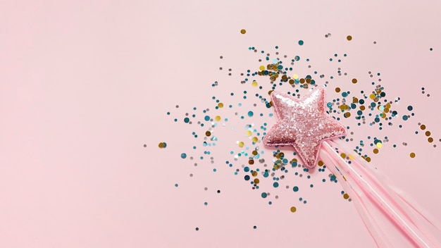 Stick with pink star and glitter top view Free Photo