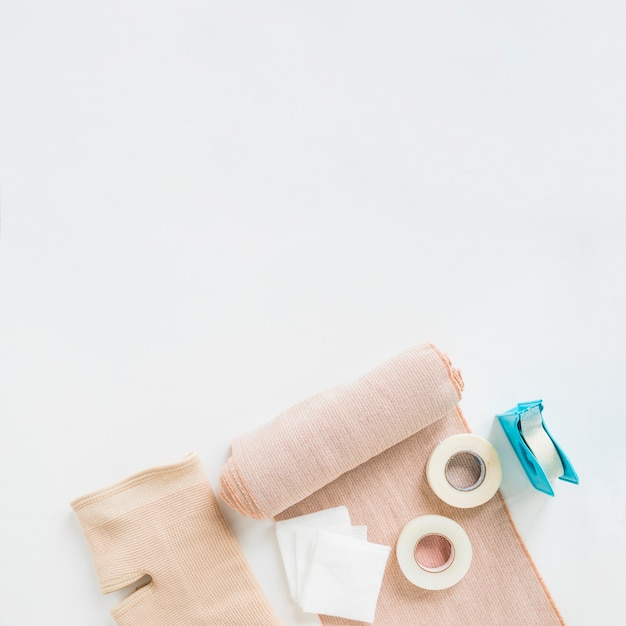 Sticking plaster; medical bandage and knee brace on white background Free Photo