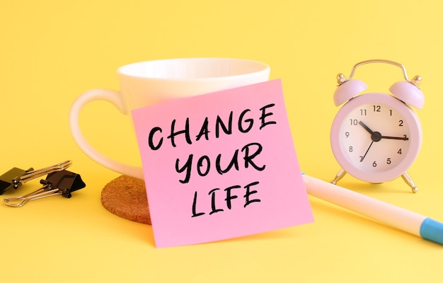 Sticky note with change your life message Premium Photo