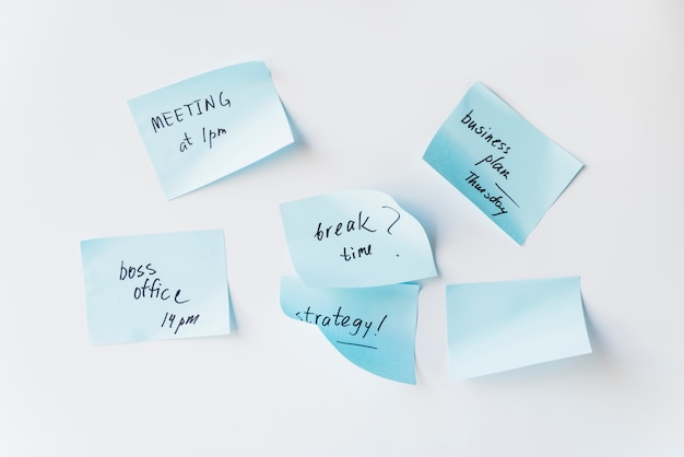 Sticky notes with plans on whiteboard Free Photo