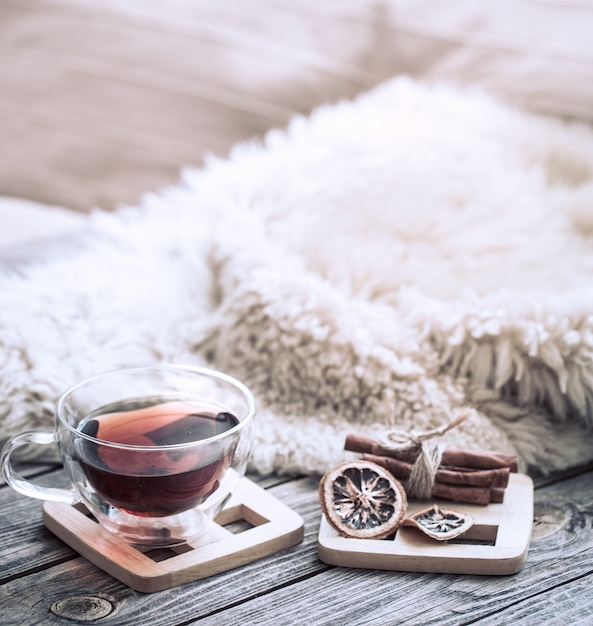 Still life cozy atmosphere with a cup of tea Free Photo
