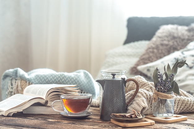 Still life details of home interior on a wooden table with a cup of tea Free Photo