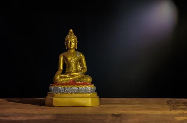 Still life golden buddha statue with light ray . Premium Photo