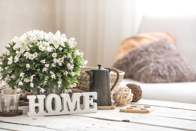 Still life in the living room with wooden inscription home Free Photo