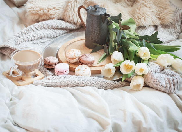 Still-life morning breakfast with coffee and macaroon Free Photo