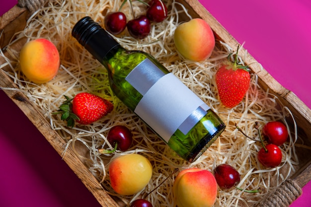 Still life with bottle and fruits on the rustic wooden tray Premium Photo