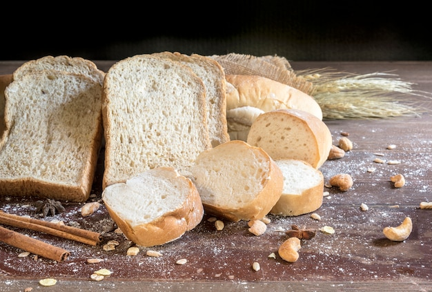Still Life With Bread And Wheat On Wooden Table Premium Photo