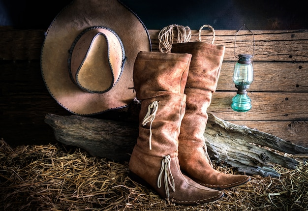 Still life with cowboy hat and traditional leather boots Premium Photo