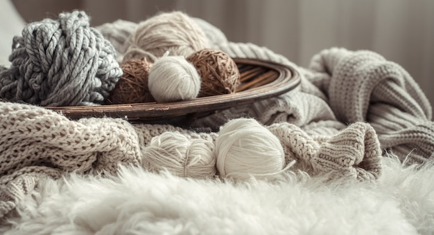 Still life with a cozy variety of yarn for knitting. Free Photo