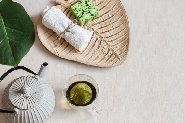 Still life with soap, towel, leaf and green tea copy space. health and beauty concept. Free Photo