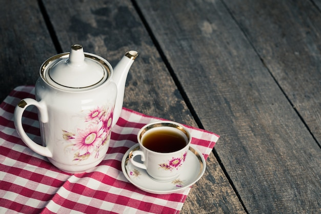 Still life with tea cup and tablecloth on wooden table Premium Photo