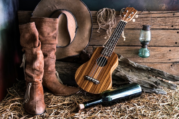 Still life with ukulele in barn studio Premium Photo