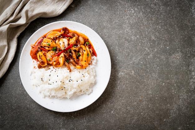 Stir-fried octopus or squid and korean spicy paste (osam bulgogi) with rice Premium Photo