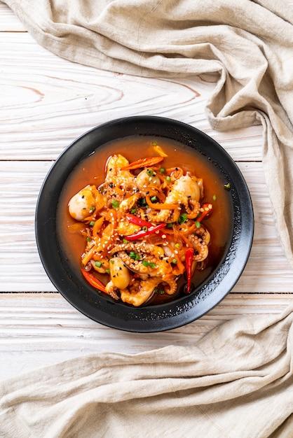 Stir-fried octopus or squid with korean spicy paste (osam bulgogi) Premium Photo