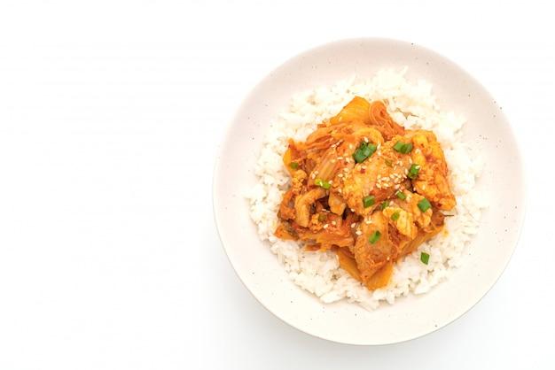 Stir fried pork with kimchi on topped rice isolated on white background Premium Photo