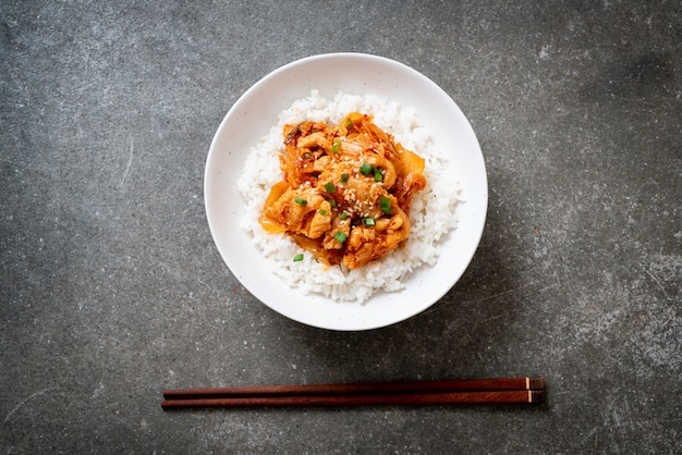Stir fried pork with kimchi on topped rice Premium Photo