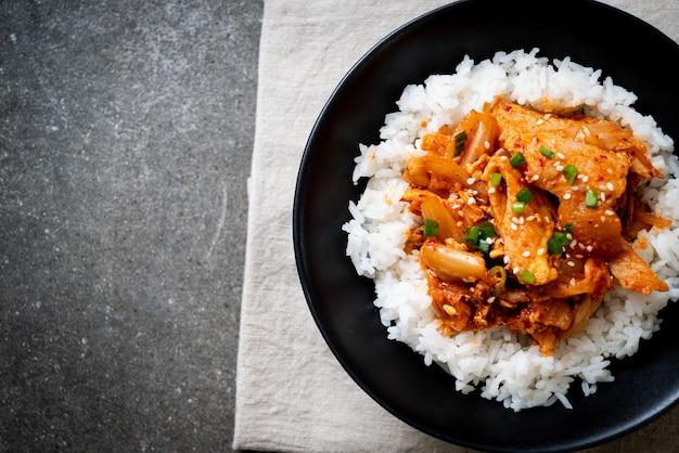 Stir fried pork with kimchi on topped rice Premium Photo