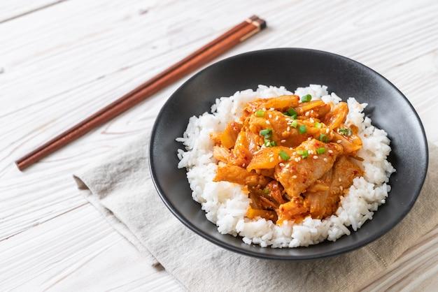 Stir-fried pork with kimchi on topped rice Premium Photo