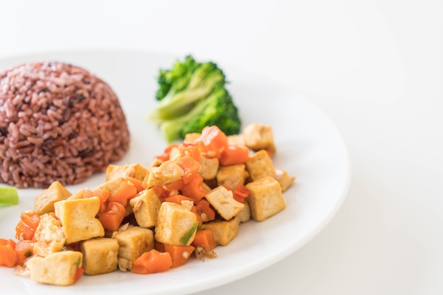 Stir fried tofu and carrot with berry rice Free Photo