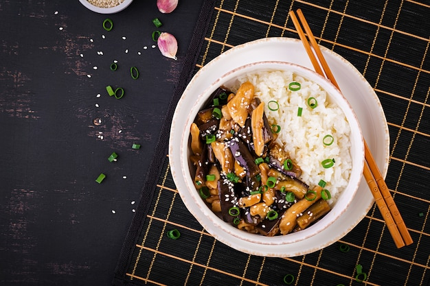 Stir fry with chicken, eggplant and boiled rice Premium Photo