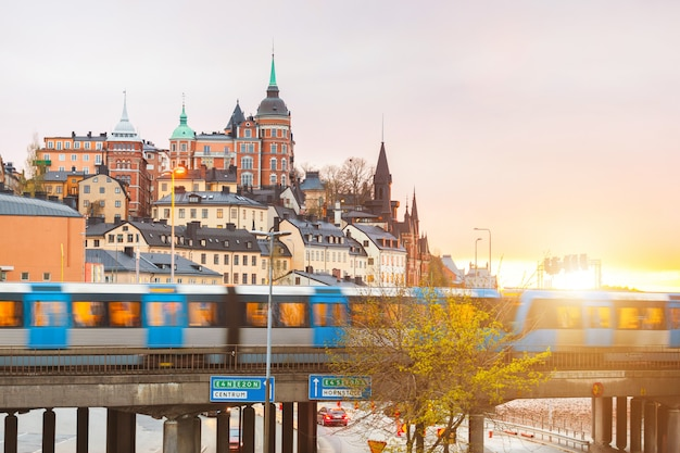 Stockholm, view of buildings and train at dusk Premium Photo