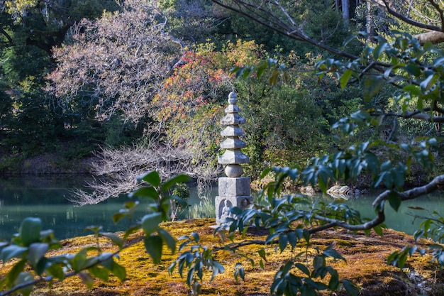 Stone buddha at carvings are inside the garden of kinkakuji temple kyoto, japan. Premium Photo