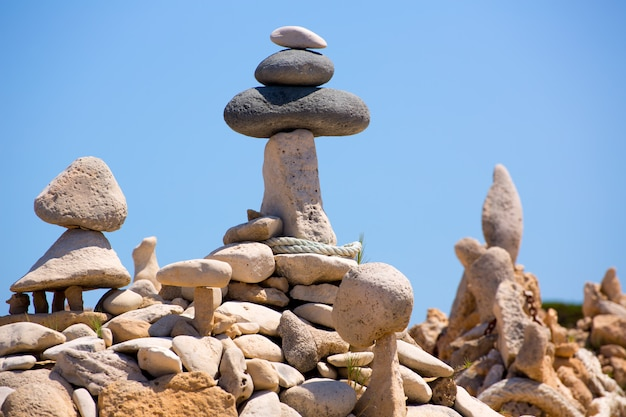 Stone figures on beach shore of illetes beach in formentera Premium Photo