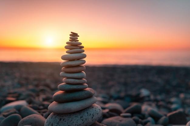 Stone pyramid at the beach Premium Photo