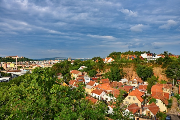 Stone quarter brno. old buildings in a former quarry. landscape with the city. Free Photo
