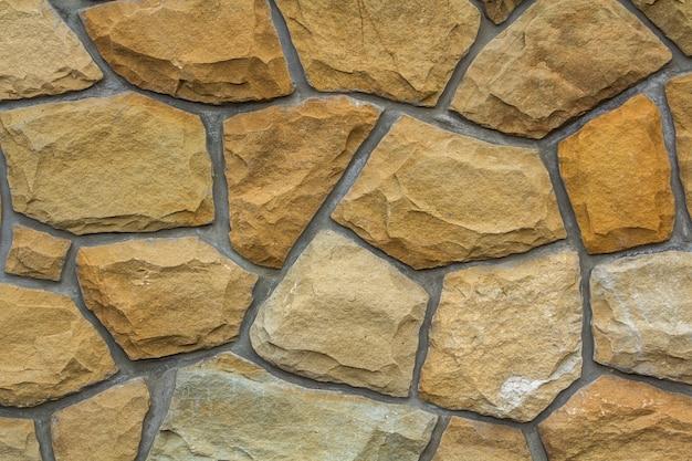 石の壁のパターンの背景 Premium写真