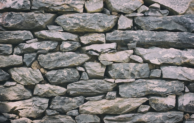 Stone wall texture or background - vintage filter Free Photo