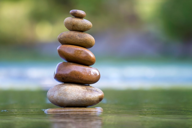Stones balanced like pile in water. Premium Photo