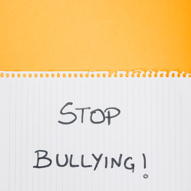 Stop bullying slogan on paper sheet