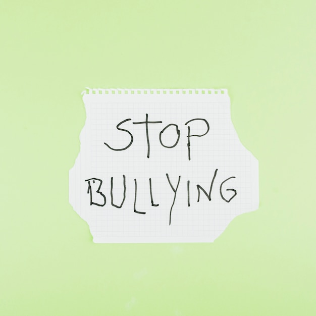 Stop bullying slogan on squared paper sheet Premium Photo