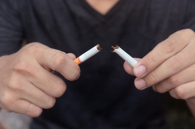 Stop cigarette, man hands breaking the cigarette with clipping path Premium Photo