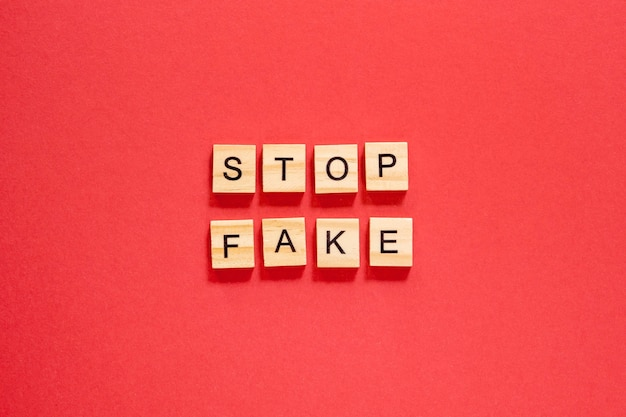 Stop fake words written with scrabble letters Premium Photo