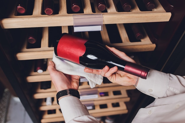 Storing bottles of wine in fridge. alcoholic card in restaurant. cooling and preserving wine. Premium Photo