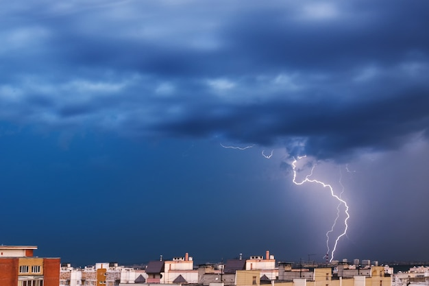 Storm clouds, heavy rain. thunderstorm and lightning over the night city. Premium Photo