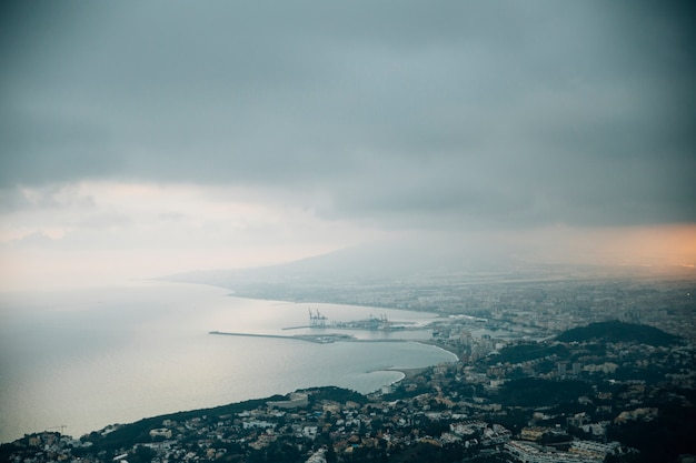 Stormy clouds over the mountain cityscape Free Photo