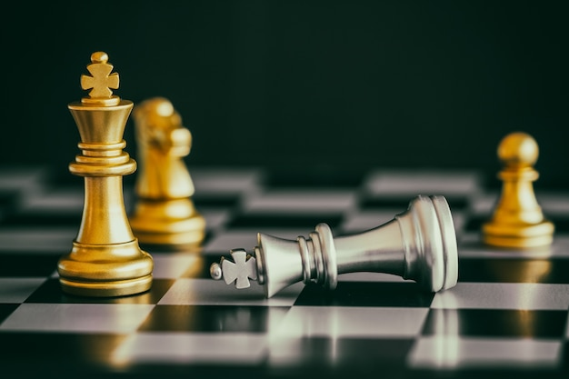 Strategy chess battle intelligence challenge game on chessboard. Premium Photo