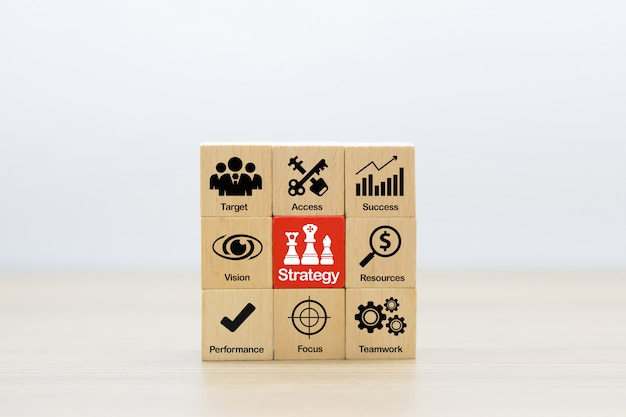 Strategy icons on wooden block for success, performance,management,and business  growth . Premium Photo