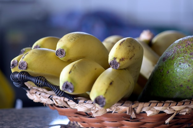 Straw basket with bunch of ripe bananas Premium Photo