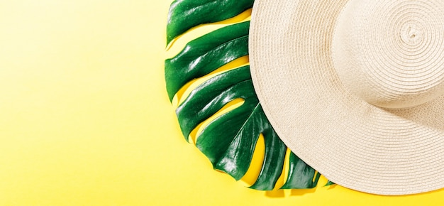 Straw hat on bright yellow sunny background Free Photo