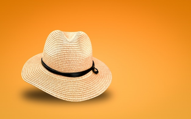 Straw hat on orange background. summer hats in banner concept. Premium Photo