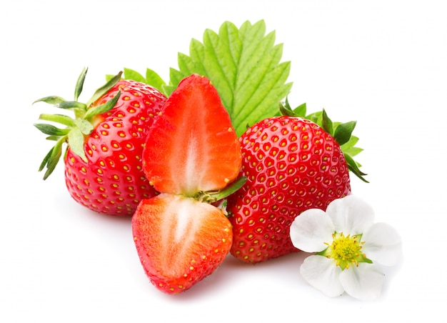 Strawberries with leaves and blossom. isolated on a white Premium Photo
