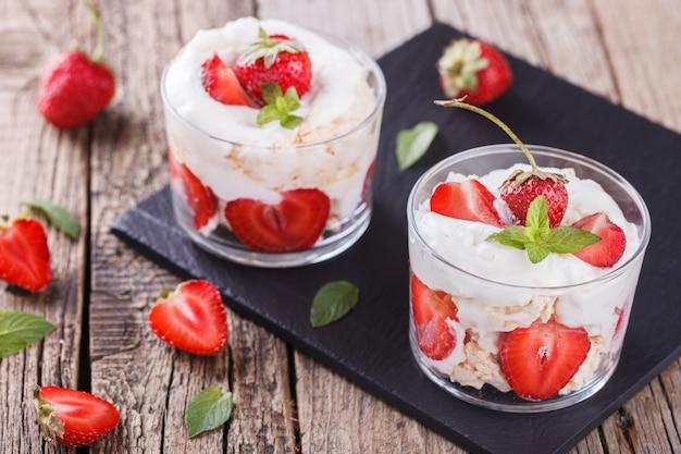 Strawberries with whipped cream and meringue Premium Photo