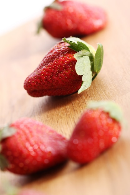 Strawberries on wooden surface Free Photo