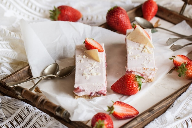Strawberry cheesecake on a dish Premium Photo