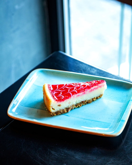 Strawberry cheesecake on the table Free Photo