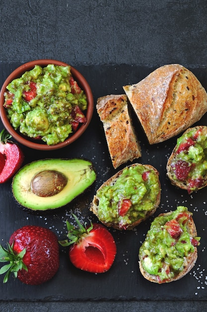 Strawberry guacamole with fitness baguette. healthy snack. keto diet keto snack. Premium Photo